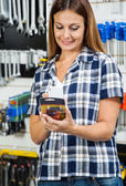 Customer Scanning Products Barcode On Mobilephone — Stock Photo