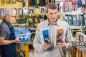 Customer Choosing Soldering Iron At Hardware Store — Foto de Stock