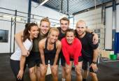 Group Of Happy Athletes Standing At cross fitness box — Stock Photo
