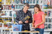 Couple Making Payment Through Smartphone In Hardware Store — Stock Photo