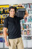 Handsome Man Carrying Toolbox On Shoulder In Store — Stockfoto