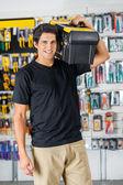 Handsome Man Carrying Toolbox On Shoulder In Store — Foto de Stock
