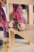 Carpenter Using Planer On Wooden Shelf — Stock Photo
