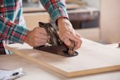 Carpenters Hand Using Plane On Wood — Stock Photo