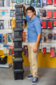 Man With Stacked Toolboxes In Hardware Store — Stock Photo