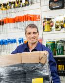 Worker With Wrapped Package In Hardware Shop — Stockfoto