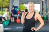 Happy Female Athlete Lifting Kettlebell — Stock Photo