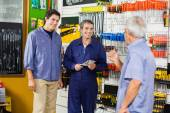 Worker With Customers In Hardware Shop — Stock Photo