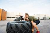 Fit Athletes Doing Tire-Flip Exercise — Foto de Stock