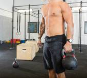 Male Athlete Carrying Kettlebell — Stock Photo