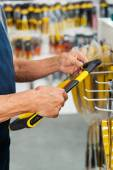 Salesman Holding Hacksaw In Store — Stock Photo