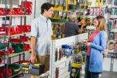 Smiling Couple Buying Tools In Hardware Store — Stock Photo