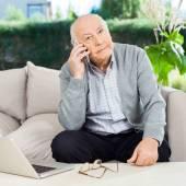 Senior Man Using Smartphone At Nursing Home Porch — Stock Photo