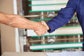 Cropped Image Of Carpenters Shaking Hands — Stock Photo