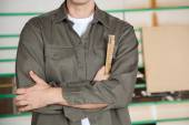Carpenter With Arms Crossed Holding Ruler — Stock Photo