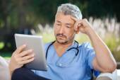 Male Doctor Using Tablet PC — Stock Photo