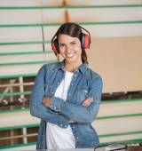 Confident Carpenter Wearing Ear Protectors In Workshop — Stockfoto