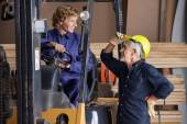 Carpenter Communicating With Colleague Using Forklift — Stock fotografie