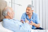 Caretaker Explaining Prescription To Senior Man — ストック写真