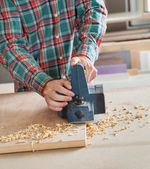 Midsection Of Carpenter Working With Electric Planer — Stock Photo