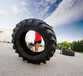 Athlete Flipping Large Tire — Stock fotografie