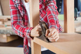 Midsection Of Carpenter Using Planer On Wood — Stock Photo