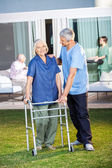 Senior Woman Being Assisted By Male Caretaker — Stock Photo