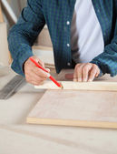 Carpenter Marking On Wood With Pencil — Stock Photo