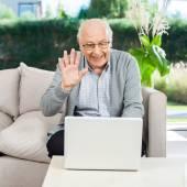 Happy Senior Man Video Chatting On Laptop — Stock Photo