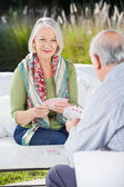 Senior Woman Playing Cards With Man — Stock Photo