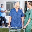 Smiling Disabled Woman And Nurse Looking At Each Other — Stock Photo #55750705