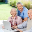 Caretaker And Senior Couple With Laptop At Nursing Home — Stock Photo #55751605