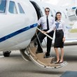 Airhostess And Pilot Standing On Private Jets Ladder — Stock Photo #55753469