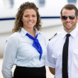 Stewardess And Pilot Standing Against Private Jet — Stock Photo #55753513