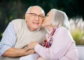 Senior Woman Kissing On Mans Cheek — Stock Photo
