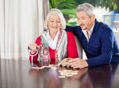 Grandmother Playing Dominoes With Grandson — Stock Photo