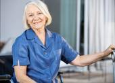 Happy Senior Woman Sitting On Wheelchair — Stock Photo
