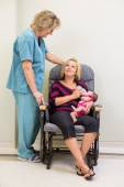 Mother Feeding Milk To Newborn Babygirl While Looking At Nurse — Stock Photo