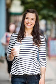 Woman Holding Disposable Coffee Cup — Stock Photo