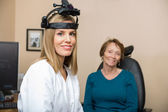 Confident Female Optometrist With Senior Patient — Stok fotoğraf