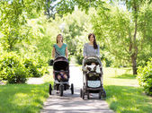 Mothers With Baby Strollers Walking In Park — Stock Photo