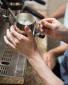 Barista Steaming Milk In Coffeeshop — Stock Photo