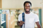 Student Carrying Backpack In Library — Stock Photo
