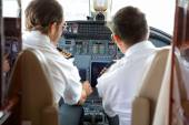 Pilots Operating Controls Of Corporate Jet — Stock Photo