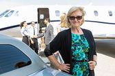 Confident Businesswoman Against Private Jet — Stock Photo