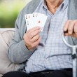 Elderly Man Showing Four Aces While Sitting — Stok fotoğraf #55939471