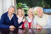 Couple Visiting Grandparents At Nursing Home — Stockfoto