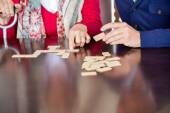 Midsection Of Grandmother Playing Dominoes With Grandson — Stock Photo