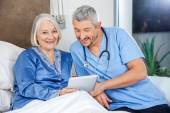 Happy Senior Woman Using Tablet PC With Caretaker — Stock Photo