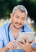 Male Nurse Using Tablet Computer — Stock Photo